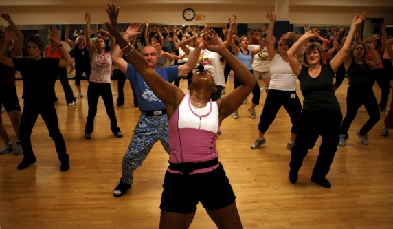 L18ZUMBA -- FOR ARTS & LIFE -- FOUR OF FIVE  Zumba instructor Christel Turner, center, of Solon, leads a class at the Jewish Community Center Monday, 15 October, 2007, in Beachwood, Ohio, USA. Photo by Tim Harrison/Special to The Plain Dealer